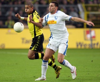 Dortmund's Zidane against a Bochum player in the 09/10 season