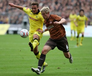 Mario Goetze against a player of Sankt Pauli
