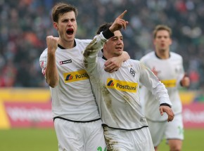 Nordtveit and Younes (r.) celebrate the 1-1