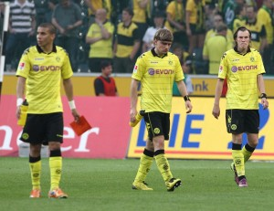 Zidan, Schmelzer and Grosskreutz after the match in MG