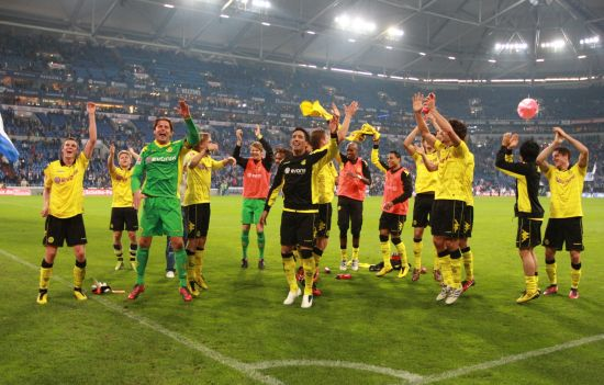 The team celebrates the victory at Gelsenkirchen