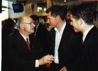 Adi Preißler mit Stefan Reuter und Lars Ricken