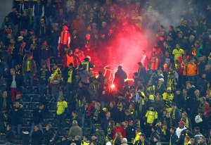 Flares shot on Dortmund fans